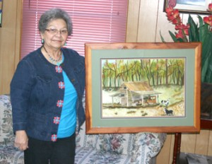 Holly Springs Baptist Church has been asked to send a mission team to help plant a church in Fort Walton Beach, Fla.  Team members are raising funds for this mission trip through church dinners on Wednesday night. A member, Gwen Chastain (pictured above), donated an original watercolor painting of a barn on Midway Road with an old A Model stored under a side shed. The barn is believed to be on Doug Thomas' property. Michael Chastain is heading up the church plant in FWB and will be ordained the day after the team arrives. For more information on making a donation please call 898-3821.