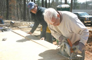 Rocky Nimmons/Courier Tom Seley of Pickens County Habitat for Humanity, right, works with Greg Lark of the Hotchkiss School during construction last Friday on a house in Pickens.