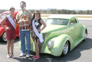 "Miss Pickens County Kendyl Chapman and Miss Pickens County Teen Allison Hale pictured with Eddie White, who won ""Best in Show"" with his 1937 Ford Wild Rod 3-w Roadster."