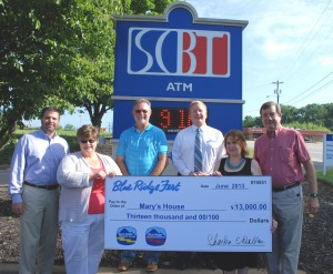 Mary's House — Representatives of Blue Ridge Fest, the annual classic car cruise-in event hosted by Blue Ridge Electric Cooperative Inc. and Blue Ridge Security, were joined by representatives from Bearden Landscaping and South Carolina Bank & Trust, Blue Ridge Fest sponsors, to present a check for $13,000 to Mary's House. Pictured, from left, are Dusty Reeves, Sales Manager, Blue Ridge Security Inc.; Denise McCormick, Manager of Customer Service and Marketing, Blue Ridge Electric Cooperative Inc.; Tommy Bearden, Bearden Landscaping; Ryan Jones, Assistant Branch Manager, South Carolina Bank & Trust; Lisa Smith Cope, Executive Director, Mary's House; and Chris Koth, Board Treasurer, Mary's House.