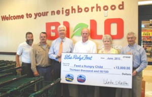Feed A Hungry Child — From left, Blue Ridge Electric Cooperative Inc. employees Tony Kelley, Bryan Roper and David Collins are joined by Blue Ridge Fest sponsors Eloise Hiott of Hiott Printing, (also representing Representative Davey Hiott), and Richie Tallman of Bi-Lo of Pickens as they present $13,000 to Feed a Hungry Child. Accepting on behalf of the charity is Mike Parrott, who serves as treasurer of the board.