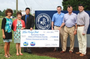 Samaritan Health Clinic of Pickens County — Representatives of Blue Ridge Fest and Martin Printing Company, sponsor of Blue Ridge Fest, present a check for $13,000 to Samaritan Health Clinic of Pickens County. Pictured, from left, Michelle Watson, Blue Ridge Electric Cooperative; Elaine Banks, Blue Ridge Electric Cooperative and board member of Samaritan Health Clinic of Pickens County; Tobias Vogel, Executive Director, Samaritan Health Clinic of Pickens County; Craig Ragsdale, Martin Printing Company; Bill Ragsdale, Martin Printing Company; and Will Ragsdale, Martin Printing Company.