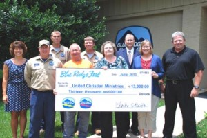 United Christian Ministries — Representatives of Blue Ridge Fest were joined by representatives from Henry D. Nix Co. and Cornell Dubilier, sponsors of Blue Ridge Fest, to present a check for $13,000 to United Christian Ministries. Pictured, from left, are Michelle Watson, Blue Ridge Electric Cooperative Inc.; Anson Perry, Blue Ridge Electric Cooperative Inc.; Kevin Lewis, Blue Ridge Electric Cooperative Inc.; Damion Ownens, Blue Ridge Electric Cooperative Inc.; Alan Blackmon, Blue Ridge Electric Cooperative Inc; Dewan Nix, Henry D. Nix Co.; Judy Gillespie, Cornell Dubilier; Pat Case, Assistant Director, United Christian Ministries; and Bryan Hester, board member, United Christian Ministries.