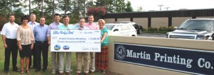 United Christian Ministries Blue Ridge Security employee Dusty Reeves and Blue Ridge Electric Co-op employees Michelle Watson and Alan Blackmon, recently presented a Blue Ridge Fest check in the amount of $13,000 to Executive Director, Teresa Nash, of United Christian Ministries. Also on hand for the presentation were Fest corporate sponsors, Wilburn Snyder of Sunset Vegetation Management, Will Ragsdale, Bill Ragsdale, Marc Ragsdale and Craig Ragsdale of Martin Printing Company, Inc.
