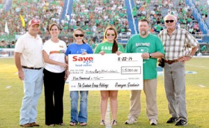 Kerry Gilstrap/Courier Officials and students pose with a check from Save-A-Lot of Pickens owner Dwayne Goodwin, left, to Pickens County Meals on Wheels at the annual Food Fight Bowl on Friday night.