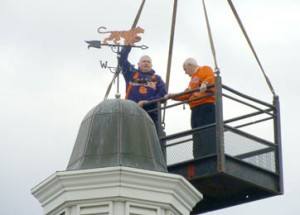 Pictured above, Hamp Summey and Bill Evatt go up on a crane to change the Hillcrest Memorial Park weather vane to represent the Clemson Tigers.
