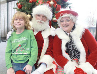 Colin Gilstrap of Pickens poses with Santa and Mrs. Claus at the World of Energy.