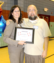 PCMOW executive director Meta Bowers presents Anthony Massengill with the Life Saver Award.