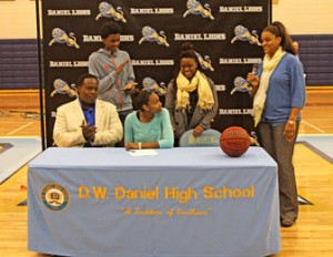 Rex Brown/Courtesy The Journal Daniel High School senior Taylour Hunter looks at her mother and girls' basketball coach, Cosandar Griffin, while surrounded by family during Hunter's signing on Wednesday at the school in Central.