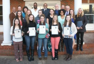 """Mayor David Owens and the Pickens City Council took a moment to honor the 2014 Pickens High School State Championship volleyball team during the regular monthly meeting on Monday. The team, along with coaches and trainers, were given the 2014 """"We Fan the Flame"""" Community Pride Award. Team members and head coach Jennifer Gravely are pictured with Owens and members of city council on Monday."""