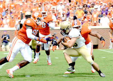 Kerry Gilstrap/Courier Clemson defenders, including former Daniel High standout Shaq Lawson, left, surround a Wofford ballcarrier during the Tigers' win on Saturday.