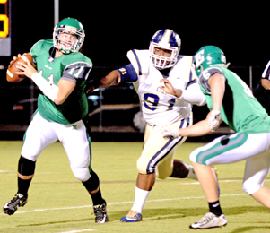 Kerry Gilstrap/Courier Easley quarterback Dalton Black scrambles away from pressure during the Green Wave's home loss to Seneca on Friday night.