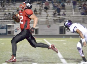 Brandy Karr/Photo Liberty's Tyler Renaud breaks free for a 70-yard touchdown run during the Red Devils' win over Walhalla on Friday night.