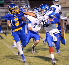 Tommy McGaha/Courier Pickens' Adam Thomas stiff-arms Wren's Trey McGowens during their game Friday night.a