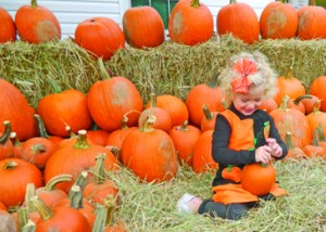 Thousands flock to Pumpkintown for the town's annual early-fall Pumpkin Festival, enjoying fall weather and beautiful arts, crafts, music and food. Above, Kinsley Simmons, daughter of Pumpkintown resident Stacey Simmons, plays with a pumpkin during a past festival.