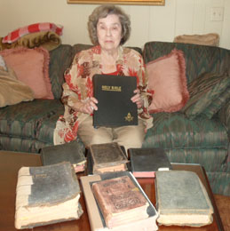 Mary Ann Ward displays her family Bibles.