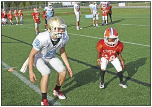 The 10-and-under Central Tigers got the chance to hit the practice field with the Daniel High School football team in the shadow of Singleton Field last Tuesday evening.  Rocky Nimmons/Courier